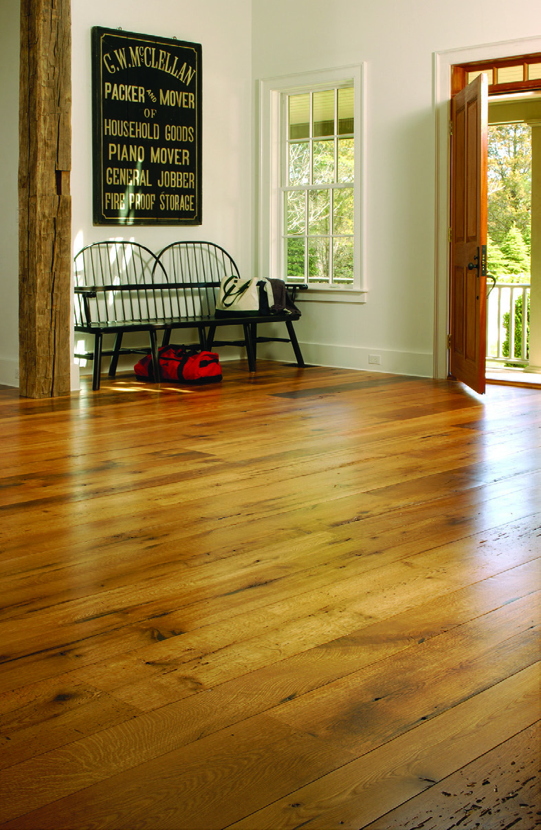 Before selecting reclaimed wood, such as the American oak flooring pictured here, be sure to factor in the relative humidity of your home. Wide board flooring may expand and contract seasonally.
